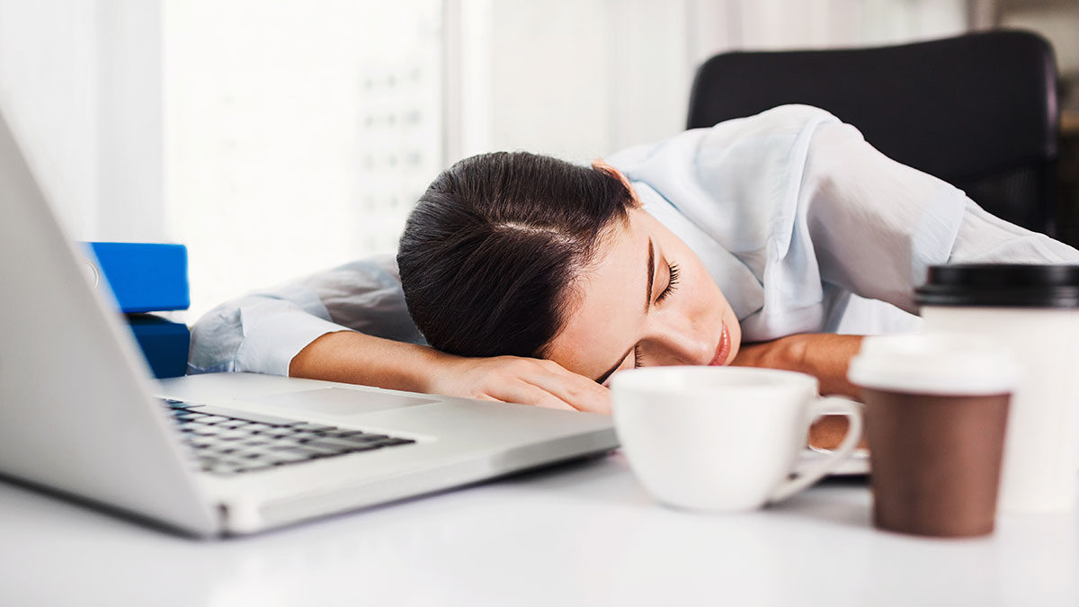 Woman with daytime fatigue asleep at her laptop