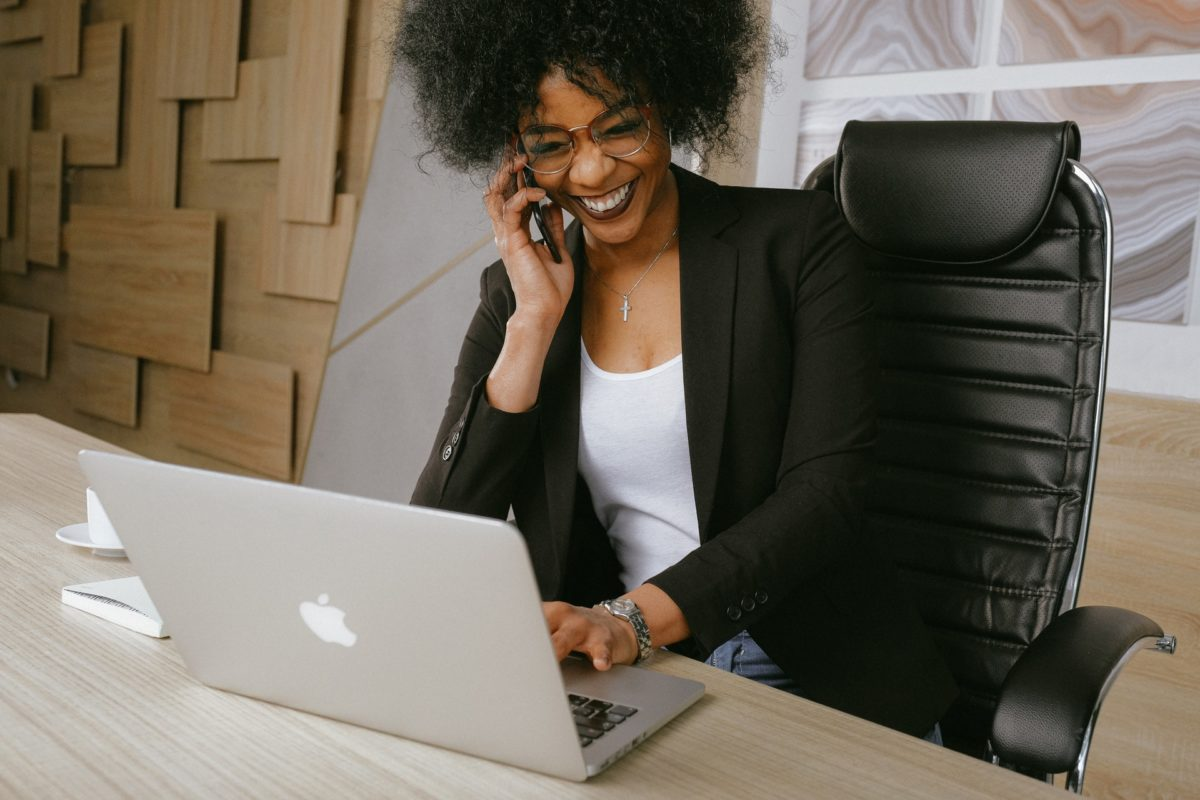 Woman working productively on her laptop after having a high quality sleep