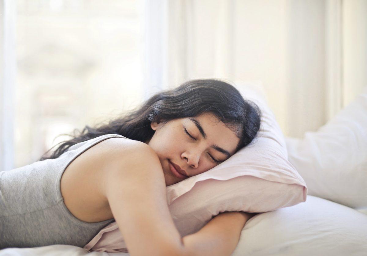 Woman sleeping on her stomach, drools during sleep
